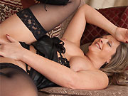 Louise Pearce milf blonde in black lingerie and stockings