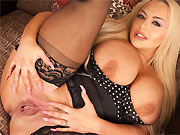 Jem Stone blonde with massive boobs poses in stockings
