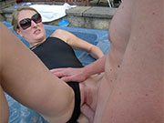 Couple having sex outdoors in lycra one piece swimsuit.