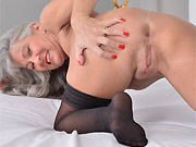 Leilani Lei tinytits mature in stockings toying on a bed