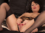 Roxanne Cox dark-haired hottie in stockings strips on a bed