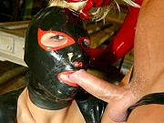 Kinky Lucy Lain in latex mask and suit giving head and getting screwed