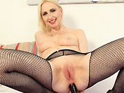 Sexy milf blonde in black stockings strips and toying