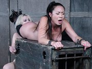 Nyssa Nevers and Nadia subs bound together in kinky bdsm dungeon