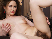 Amateur milf brunette strips and shows hairy pussy
