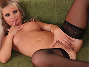 Lucy Dusk in black stockings fingers pussy on sofa