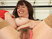 Busty milf in stockings shows hairy twat close up