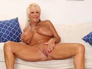 Sexy old woman gets naked and shows off her mature pussy and juicy tits