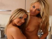 Becky Roberts posing with her blonde girlfriend