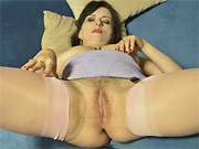 Horny milf in stockings shows a hairy pussy