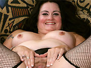 Victoria Powers in black lingerie and stockings stripping