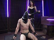 Chelsea Marie latex dominant tranny spanks and fucks chained sub