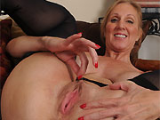 Jenna Covelli busty milf blonde poses in black stockings