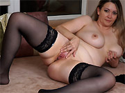 Busty amateur mom in black stockings fingers pussy