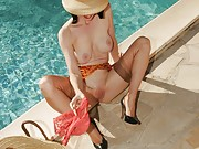 Naughty mature in stockings panty stuffing by the pool