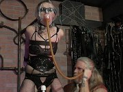 Abigail Annalee put in a cage and bound for sex toying by master