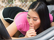 Asian cutie treats him to a sneaky blowjob in the car
