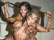 Salma De Nora fighting a busty lesbian in the mud and licking her pussy