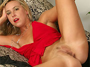 Horny milf blonde in red dress plays pussy on sofa