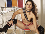 Latina in thigh boots spreading