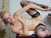 Sexy milf blonde Artemia poses in black stockings