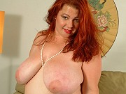 Big breasted redhead fatty in white lingerie getting nasty on couch