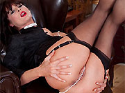 Milf brunette in black corset and stockings plays pussy