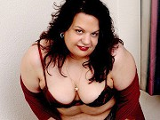 Brunette mature fatty Gina getting naked and modelling nude at home