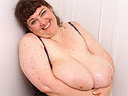 Fat woman in shower reveals massive boobs