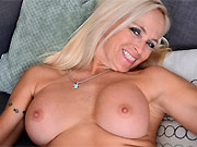Dani Dare busty milf blonde shows striptease on a sofa