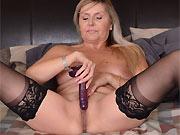 Velvet Skye mature blonde in black stockings spreads on bed