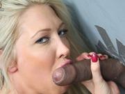 Sweet busty blonde sucks and assfucks at gloryhole