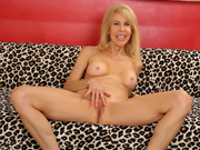 Sexy old woman gets naked and exhibits her mature tits and pussy