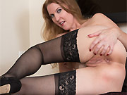Long-legged milf blonde Lacy F poses in black stockings