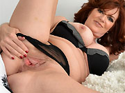 Andi James busty milf in lingerie fingers twat close up