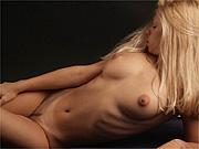 Erotic nude blonde in studio shoot