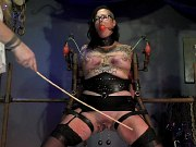Kali Danes in black stockings is bound for spanking and toying