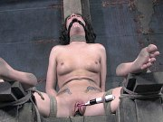 Taylor Mae is spread bound in rope and toyed by lezdom in dungeon