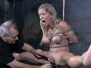 Dia Zerva busty in black dress is rope spread bound in dungeon