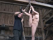 Cherry Torn busty is rope bound in different positions in a barn