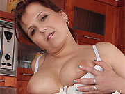 Marie Jeanne busty milf housewife toying cucumber on kitchen