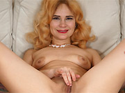 Adelis Shaman sexy milf blonde poses nude on a sofa