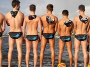 Sydney gay waterpolo team photos shoot in their team speedos.