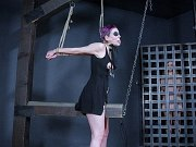 Sierra Cirque in black bound in kinky dungeon her nipples clamped
