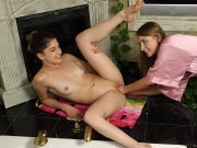 Lesbian babe gets juicy shaved pussy fisted in tub