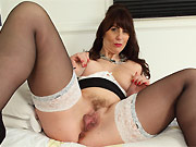 Toni Lace busty milf in black stockings spreads on bed