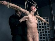 Lexi Foxy is spread bound in rope and toyed by maledom in dungeon