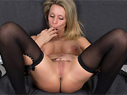 Bigboobs milf blonde in black stockings plays a twat