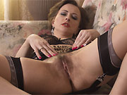 Hairy milf hottie in tan stockings stripping on a sofa