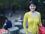Asian teen cutie flashing her perky tits